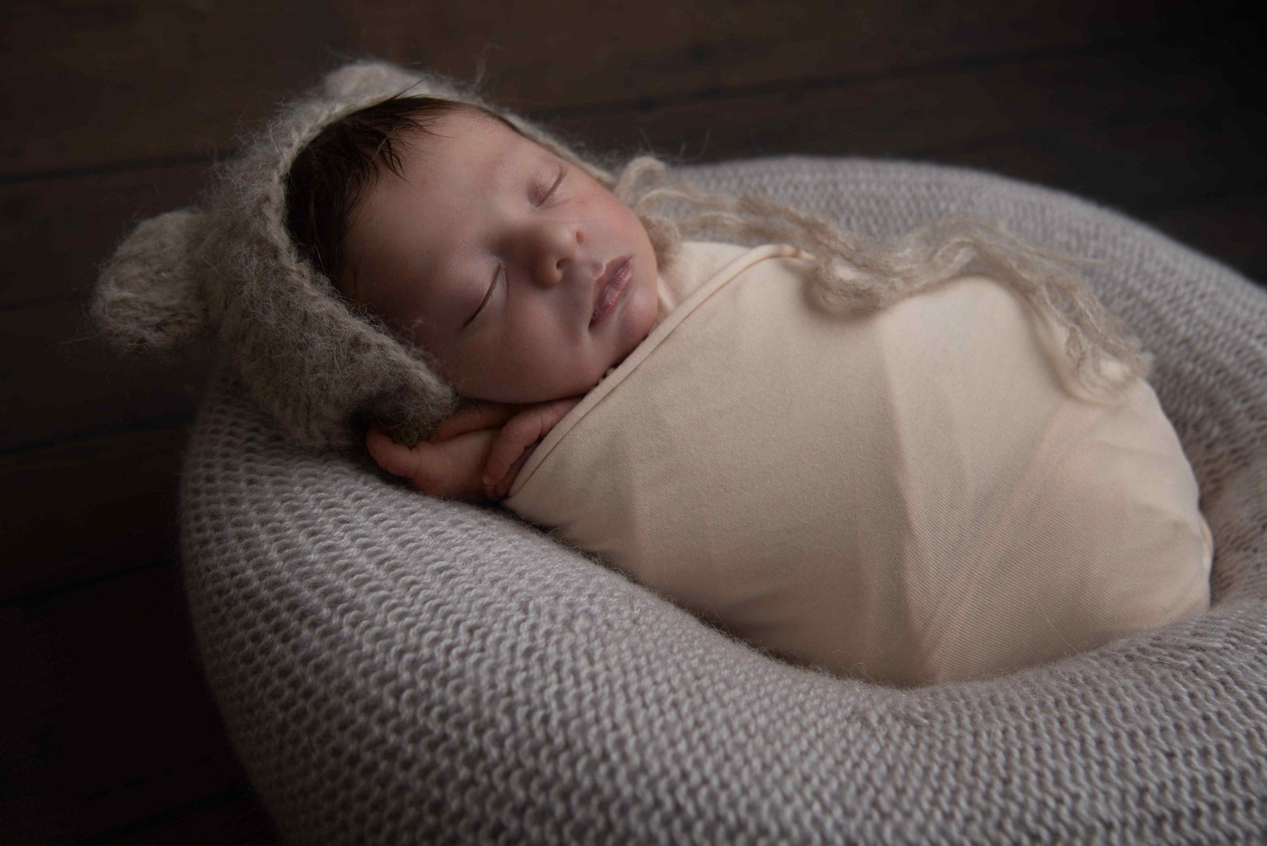 newborn baby, newborn boy, wrapped with felted bunny and teddy bear hat